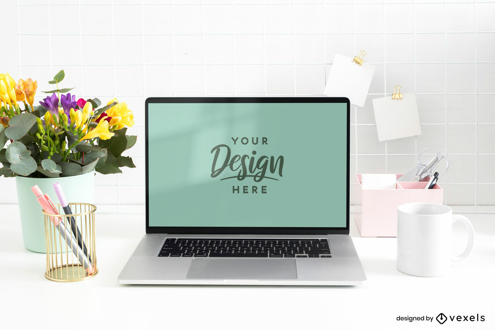 Laptop in desk with flowers mockup