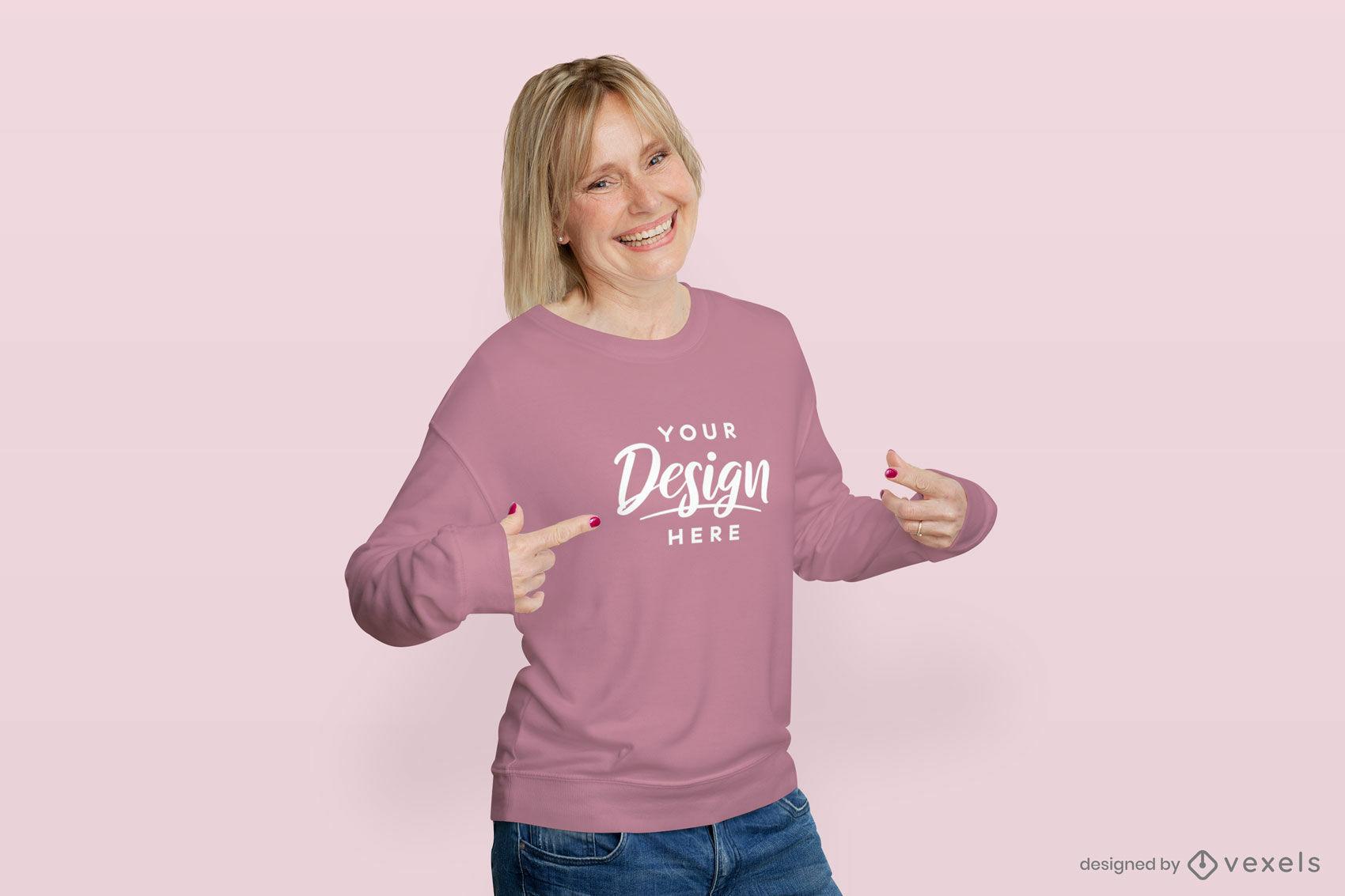 Mujer en fondo plano de maqueta de sudadera rosa