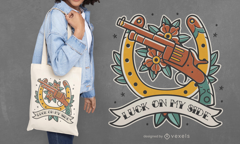 Dise?o de bolso de mano con pistola de vaquero y herradura.