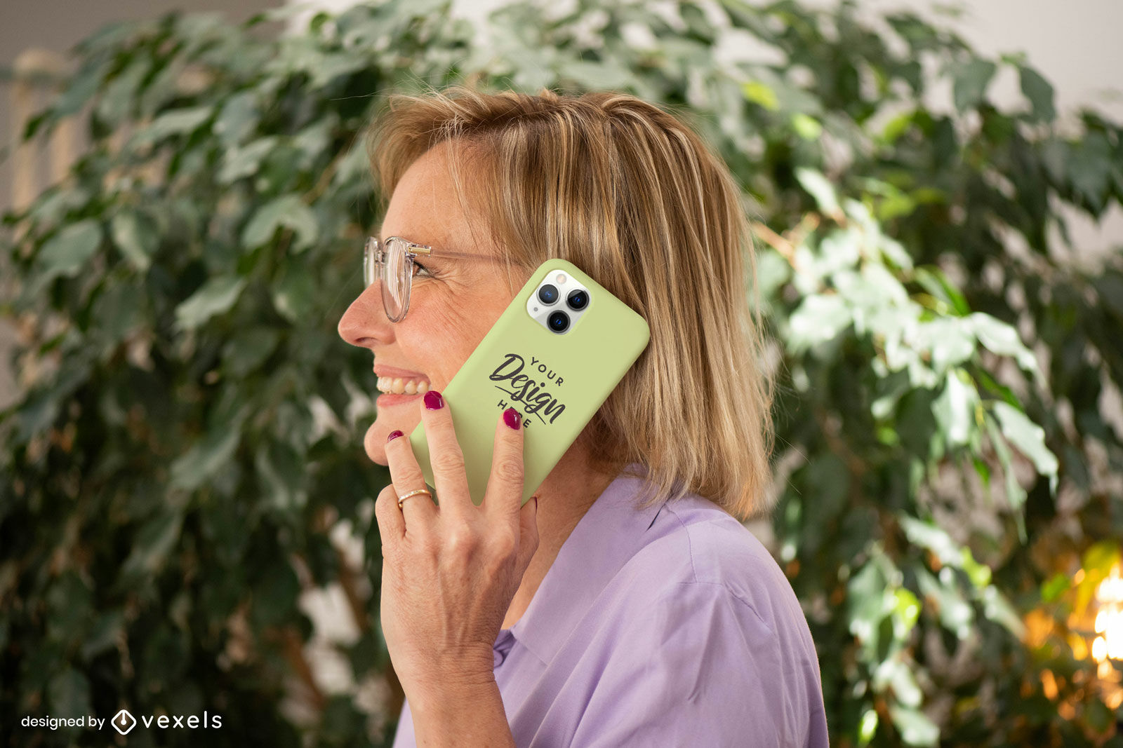 Woman with yellow phone case mockup in garden