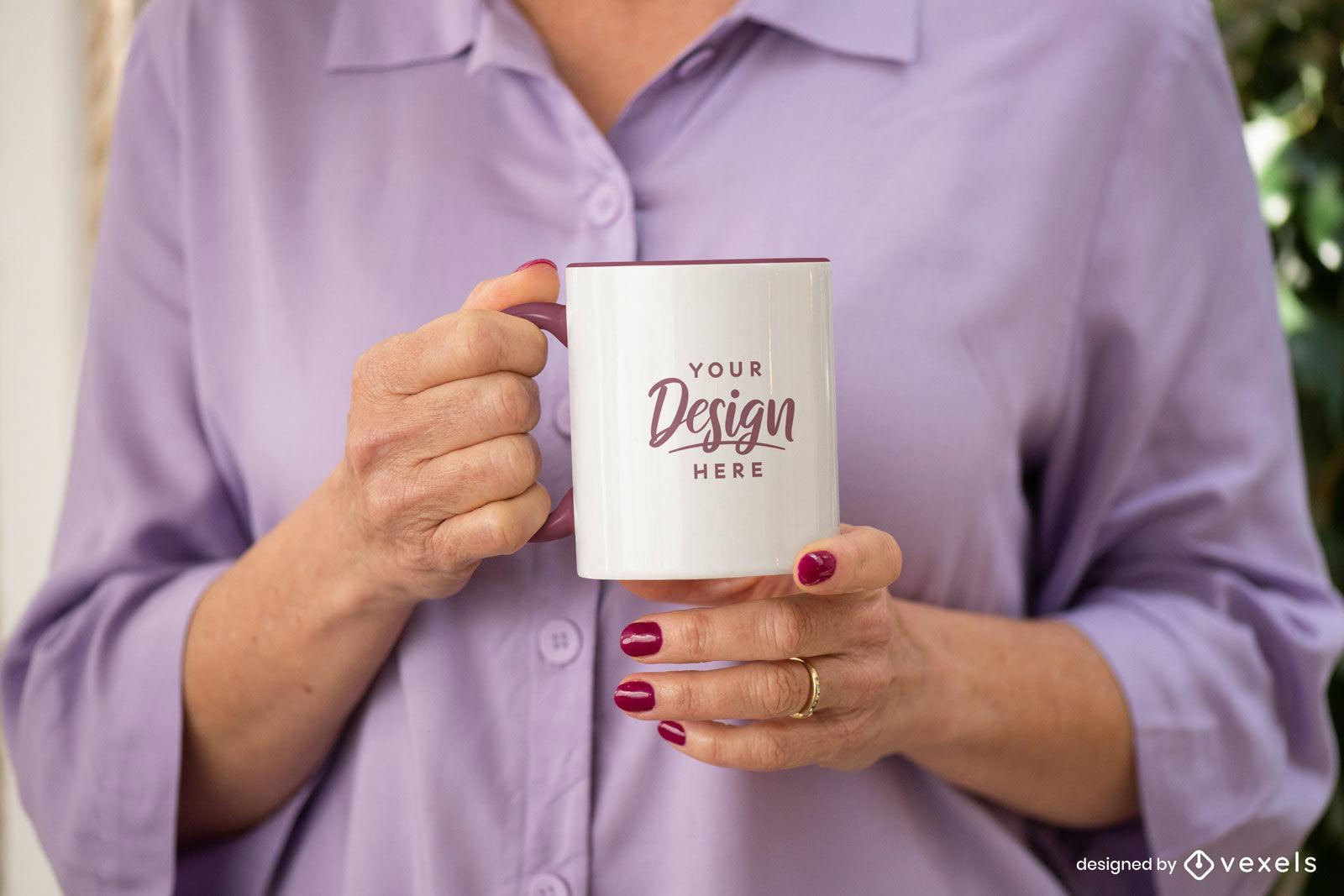 Woman holding white and purple mug mockup