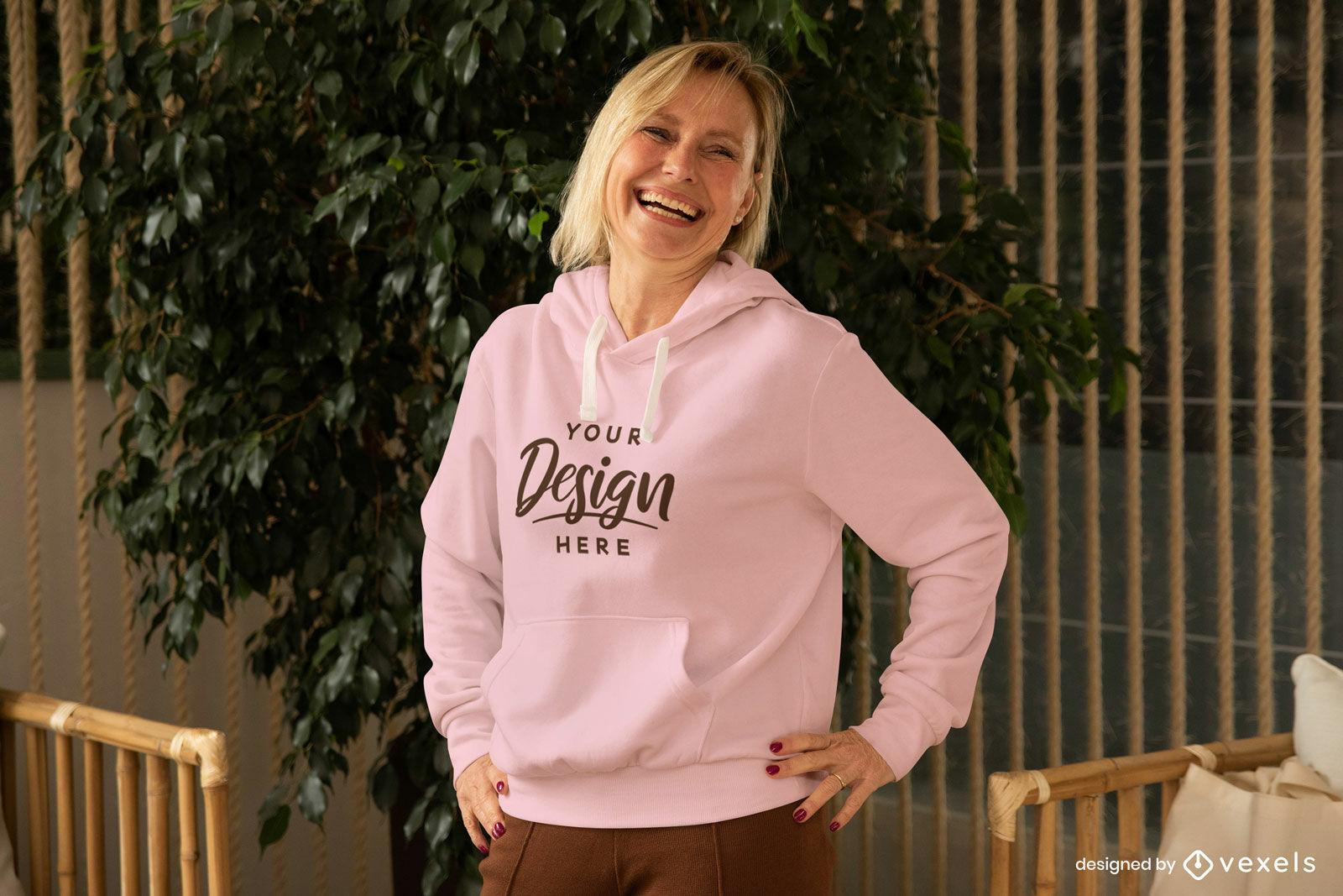 Female model in pink hoodie mockup