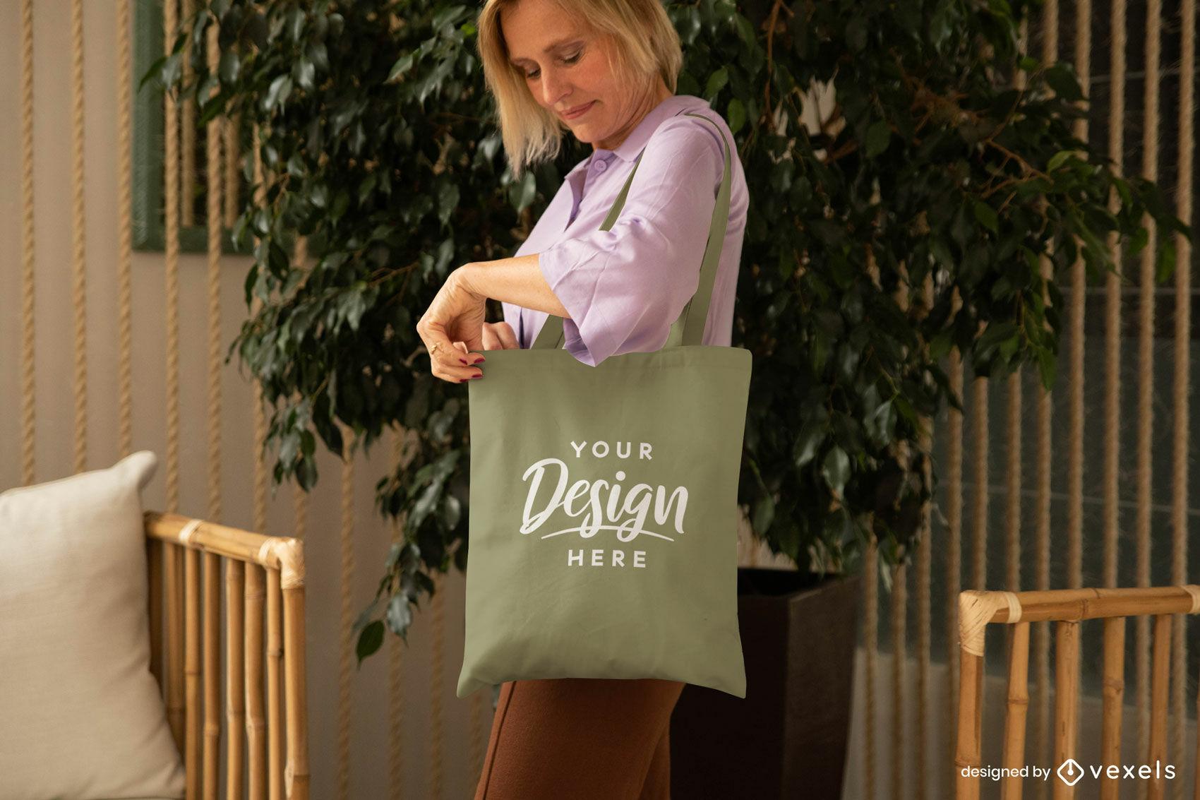 Woman mockup of green tote bag