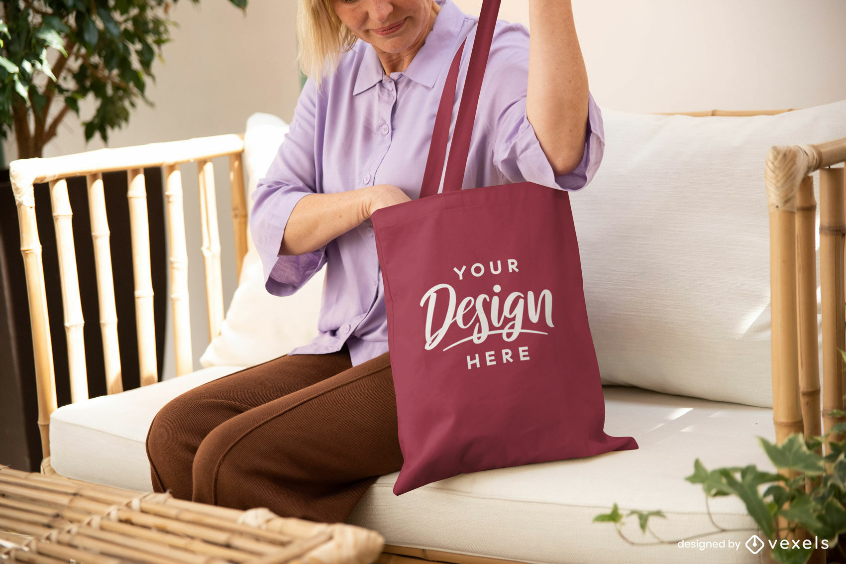 Woman with maroon tote bag in couch mockup