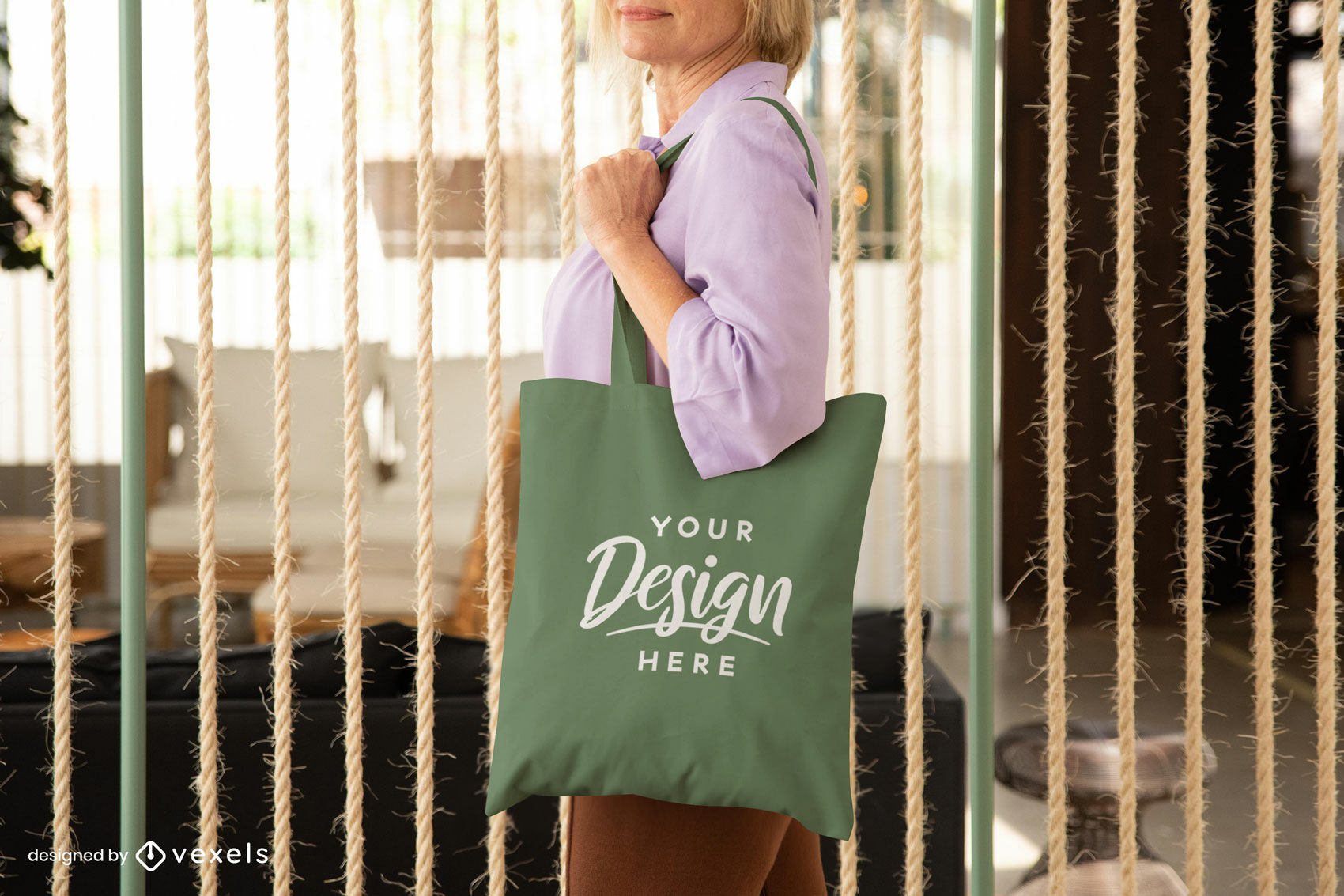 Woman with green tote bag in living room mockup