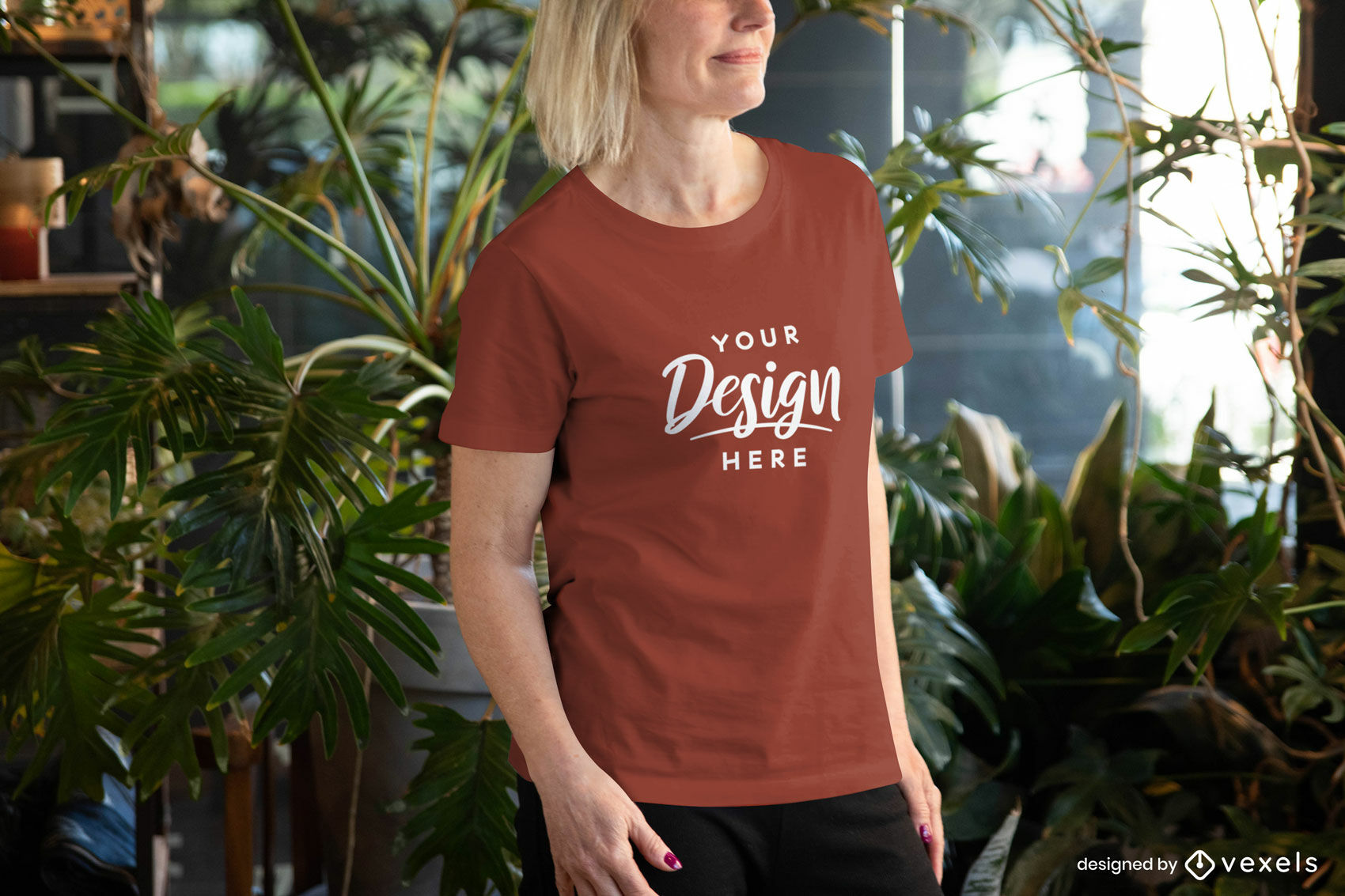Woman in red t-shirt mockup in room with plants