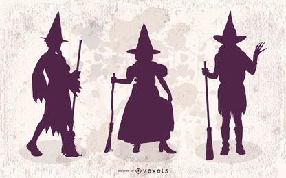 3 meninas em fantasias de bruxa de Halloween