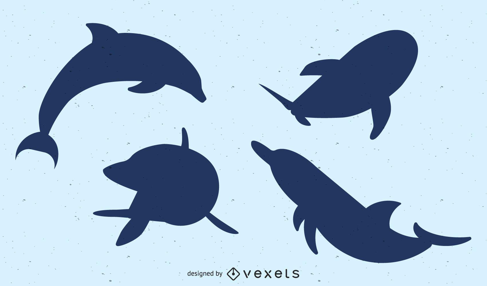 Paquete de delfines silueta