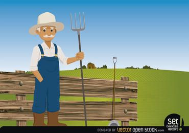 Farmer tridente en su granja