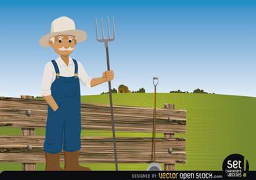 Landwirt Mistgabel auf seiner Farm