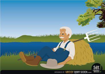 Granjero descansando junto a un lago