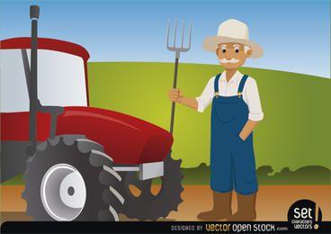 Agricultor com forcado ao lado de seu trator