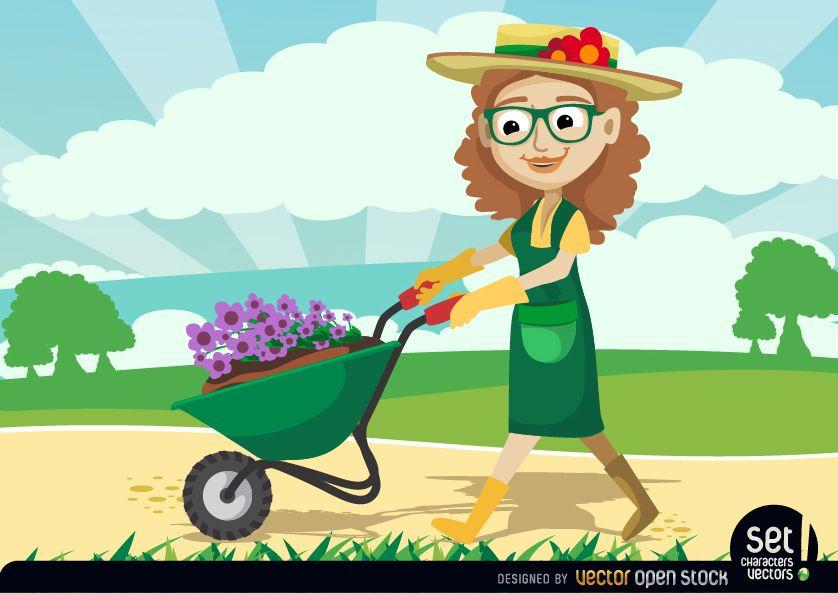 Jardinero mujeres llevando plantas por carretilla