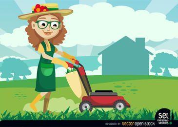 Jardineiro feminino com máquina de corte de grama