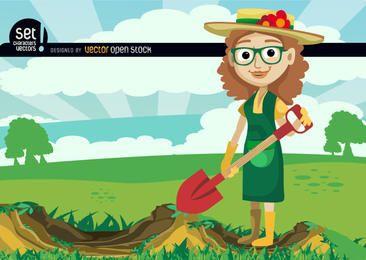 Menina de cavar com pá em campo verde