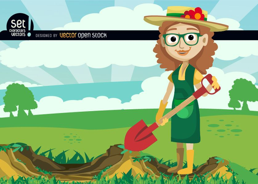 Chica cavando con pala en campo verde