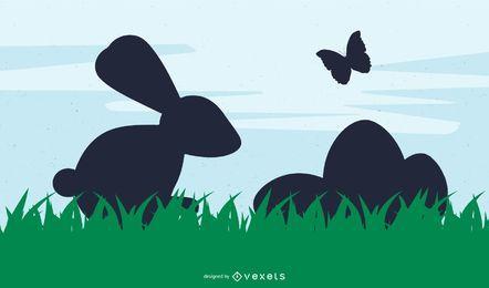 Conejito de Pascua silueta y huevos sobre hierba