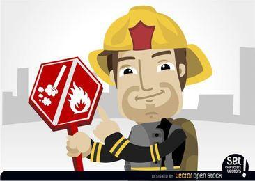 Fireman apuntando signo de riesgo ardiente