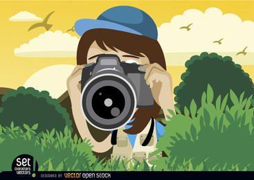 Menina fotografando com a câmera