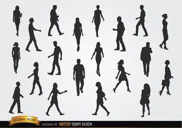 Conjunto de siluetas de personas caminando