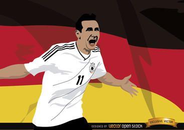 Miroslav Klose con la bandera de Alemania