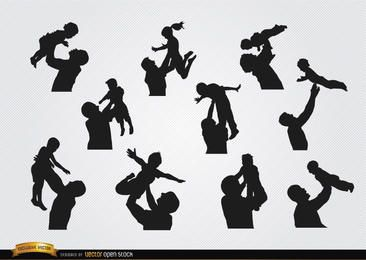 Fathers raising children silhouettes