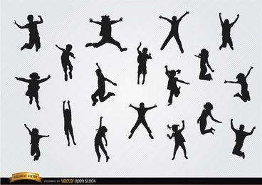 Conjunto de silhuetas de crianças pulando