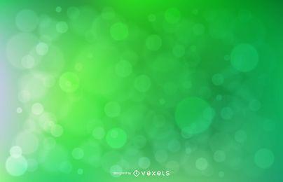 Círculos abstractos de Bokeh sobre fondo verde