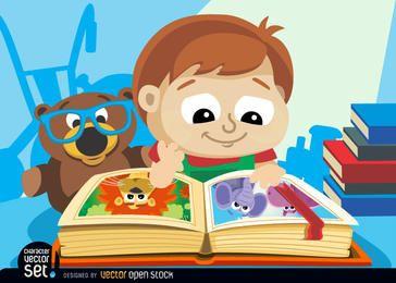 Garotinho com livro ilustrado
