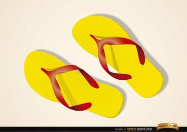 Sandálias de praia na areia