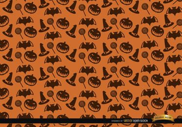 Halloween-Beschaffenheitshut-Süßigkeitsschläger und gruseliger Kürbishintergrund
