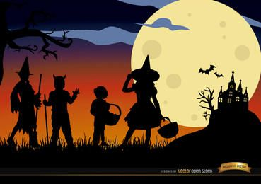 Halloween children disguised silhouettes background