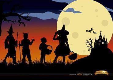 Halloween crianças disfarçadas silhuetas fundo