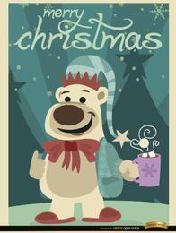Oso de la Navidad con chocolate caliente