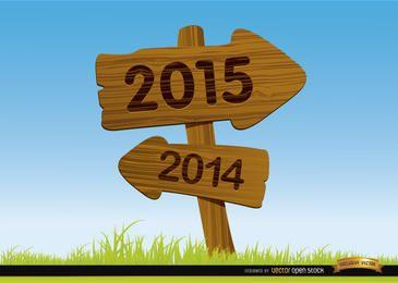 2015 sinais de seta de madeira fundo