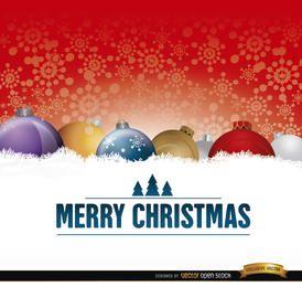 Bolas de Natal no cartão de neve