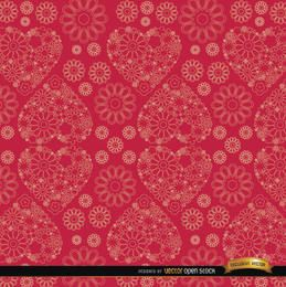 Flores y corazones patrón de fondo rojo