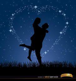 Pareja amor estrellas de la noche de fondo