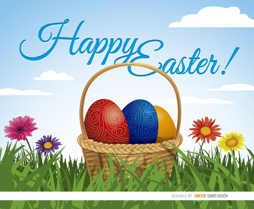 Easter eggs basket on grass background