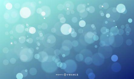 Bokeh blendet glänzenden blauen Hintergrund
