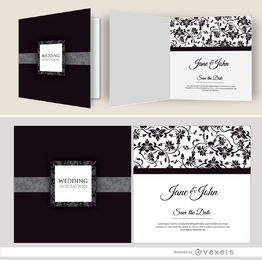 Open black floral wedding invitation