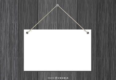 Placa de papel em branco pendurado na madeira