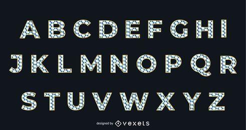 Tipografía alfabética dorada con textura de diamante