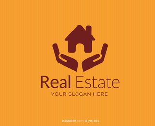 Casa em mãos logotipo imobiliário