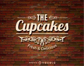 Logo de cupcakes sobre un brickwall