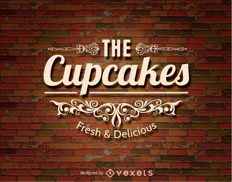 Logotipo de cupcakes sobre una pared de ladrillos