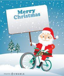Papá Noel en bicicleta con letrero