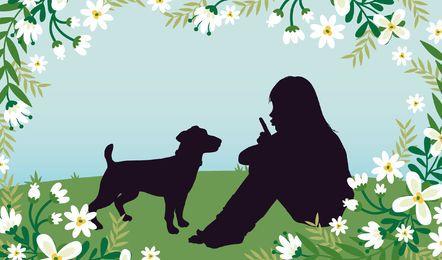 Chica con el perro de hierba Campo