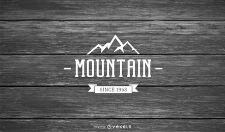 Mountain Logo on Wooden Background