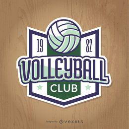 Insignia de voleibol vintage en verde y azul.